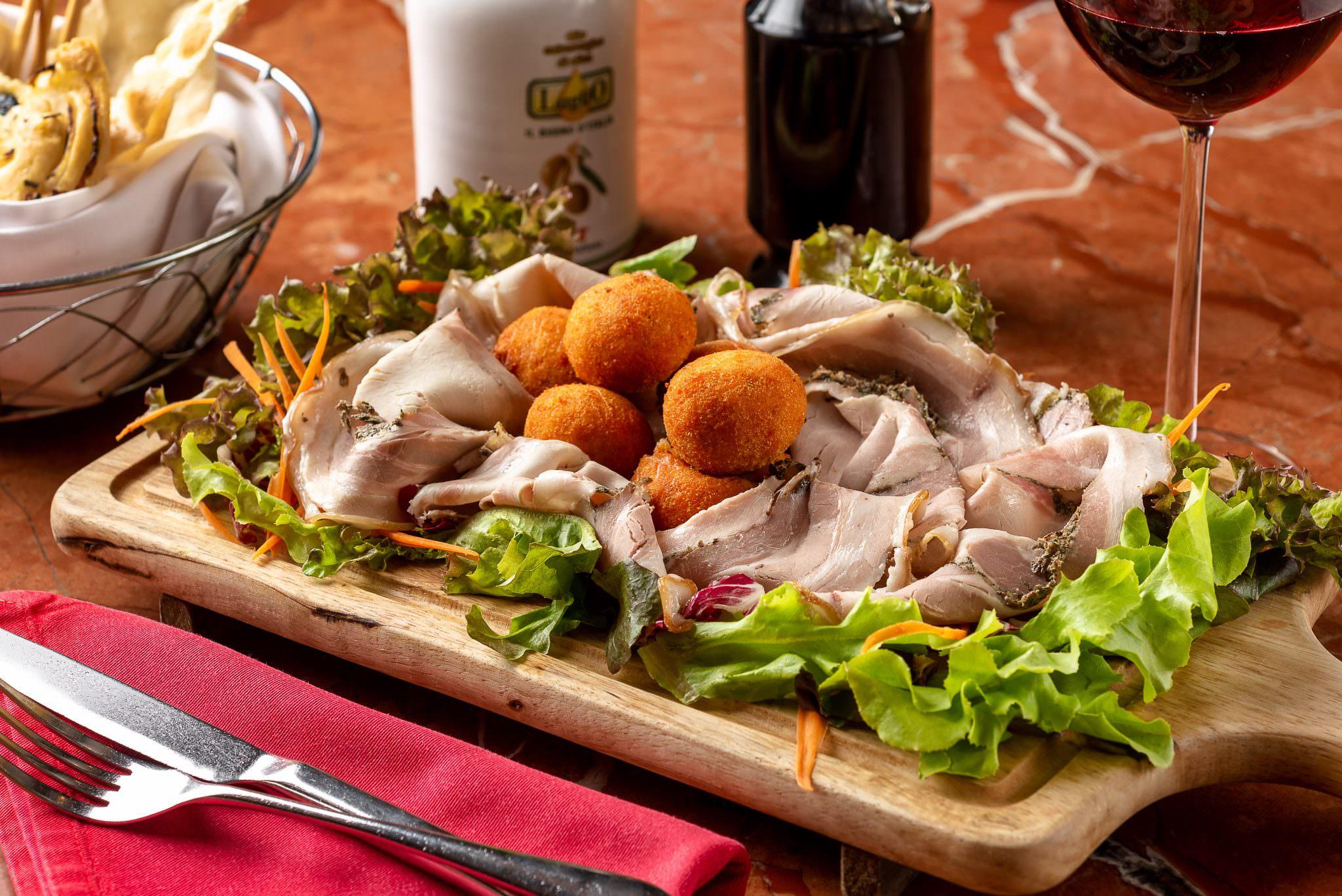 Traditional Porchetta Romana and Arancini di Riso with spicy Nduja Calabrese sausage and mozzarella cheese.